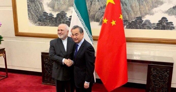 ملاقات ظریف با همتای چینی؛محور مصاحبه درباره چیست؟، عکس